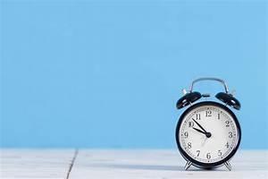 Decorative alarm clock with blue background Photo | Free ...
