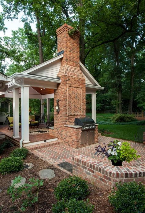 a backyard retreat with covered porch and open patio wood