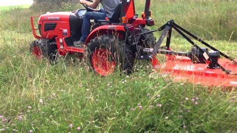23 hp kubota with 4 ft land pride brush hog - YouTube