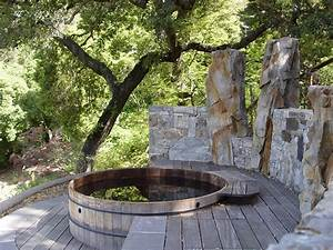 Hot tub deck designs deck rustic with boulders decks hot for Whirlpool garten mit rollrasen balkon katze