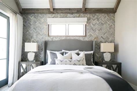 master bedroom features herringbone textured accent wall