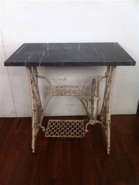 side table with vintage singer sewing machine base
