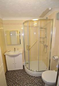 Corner shower small bathroom layout basement remodel for Small bathrooms with corner showers
