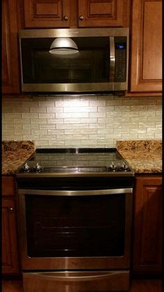 granite counters tile backsplash    range