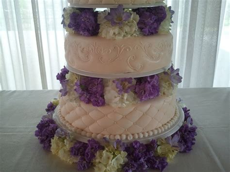 Fresh Purple And White Flowers With Ivory Wedding Cake
