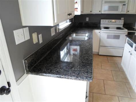 faucet sink kitchen caledonia granite 4 12 13 granite countertops installed in