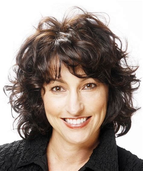 medium curly casual hairstyle with layered bangs black hair color