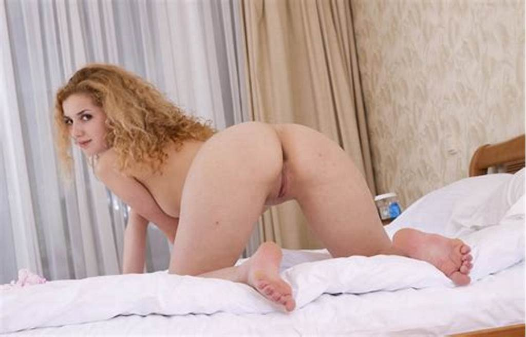 #Lovely #Curly #Blonde #Posing #On #Bed