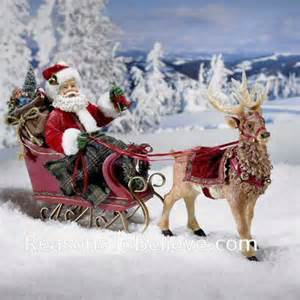 santa in sleigh with reindeer santa claus figurines and hand carved wooden santas