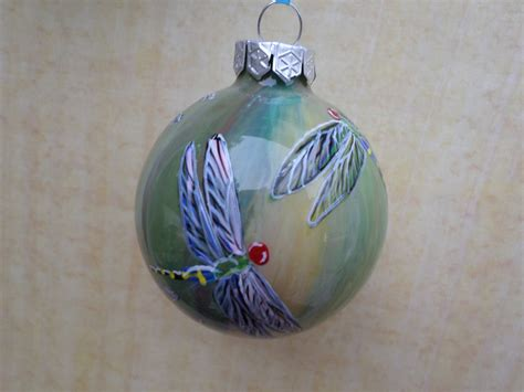 hand painted glass ornament with dragonflies by