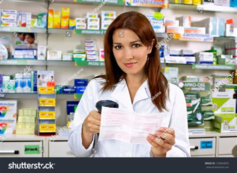 pharmacy ls for reading beautiful redhead doctor working in pharmacy smiling