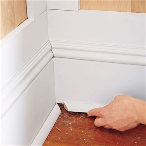 installing floor moulding install the base cap and shoe moldings how to install wainscoting this old house