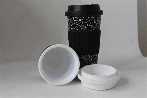 Free floating plastic bottles mockup. Eco friendly double wall plastic thermal coffee bottle ...