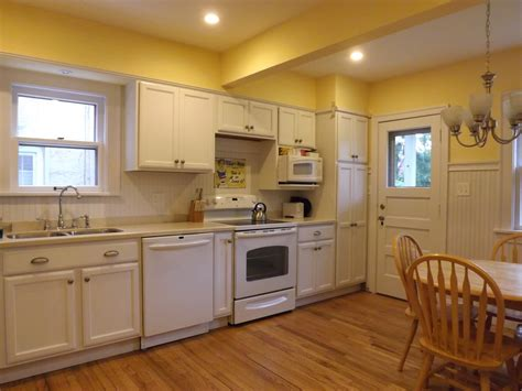 yellow and white kitchen ideas white kitchen white beadboard back splash kraftmaid