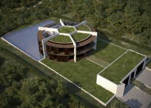 luis de garrido designs football shaped eco mansion for lionel messi