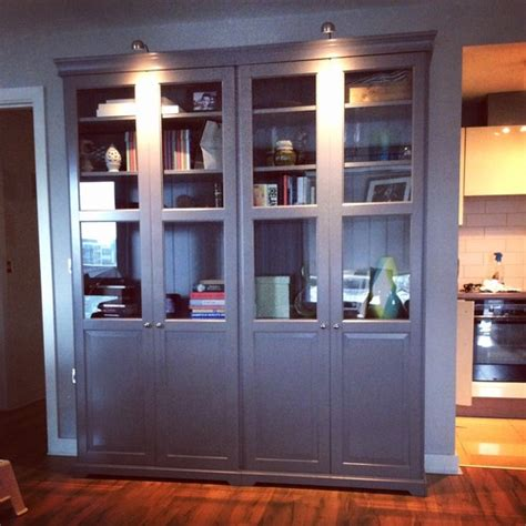 IKEA Liatorp Grey Bookcase with half glass doors.