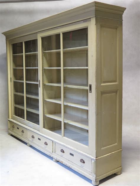wood bookcase with glass doors light brown wooden bookcase with three shelves plus double