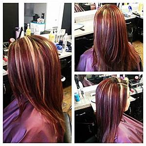 Red and blonde highlights on brown hair. I'd want a lil ...