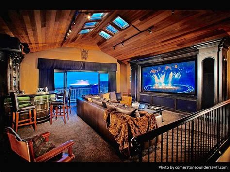 floor  ceiling windows open   cozy man cave equipped   bar area large flat screen