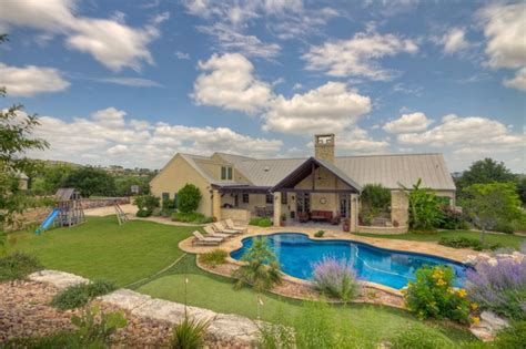 Hill Country Ranch II   Tropical   Exterior   Austin   by Tony Roberts Custom Homes