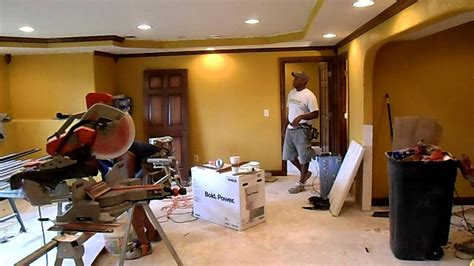 Adding Tray Ceiling by Installing Maple Crown Molding On Basement Tray Ceiling
