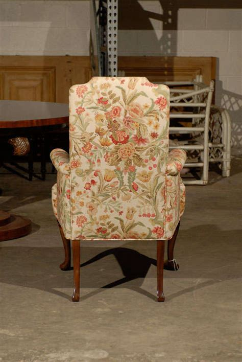 pair of upholstered host and hostess chairs at 1stdibs
