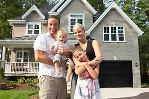 Happy Family In Front Of Their New House - Mainmark | Mainmark