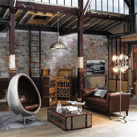 canape chesterfield noir comment intégrer la table basse style industriel dans le salon