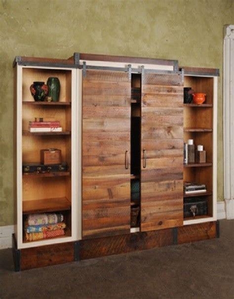sliding barn door bookcase barn door sliding wall unit pinterest shelves on the