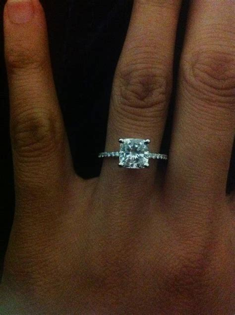 cushion engagement ring with dainty pave band