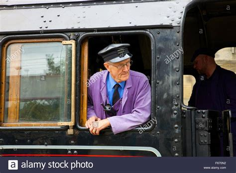Engine Driver In The Cab Of Steam Train Lms Jubilee Class