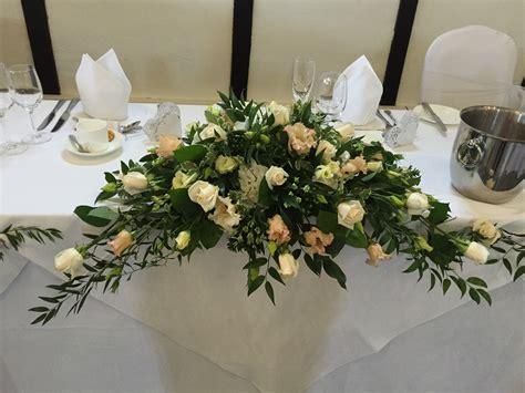 top table arrangements sues flowers  harlow epping