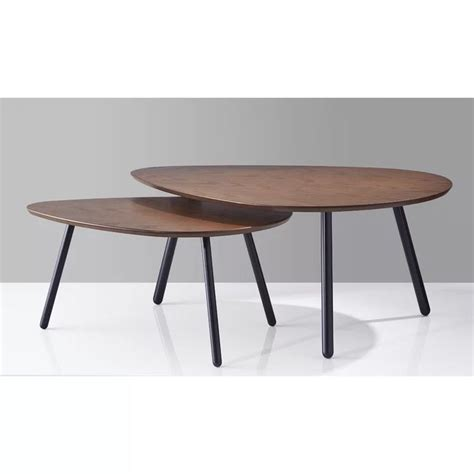 Rather than slouching down to your computer or your plate, this coffee table raises the surface from 18.5 to 24.6 inches high and moves it closer to your lap to allow for better posture during work or mealtime. Irvin Nesting 2 Piece Coffee Table Set in 2020 | Round coffee table, Oval coffee tables ...