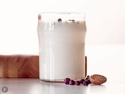 To make a white russian, start by filling a highball glass to the top with ice. White Russian Coffee   On Trend   feastmagazine.com