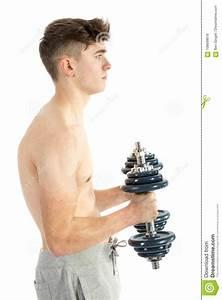 18 year boy lifting weights stock photo