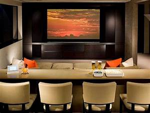 Tips on dealing with the right home theater design for the for Kitchen cabinets lowes with theater room wall art