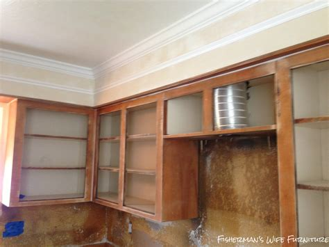 space between kitchen cabinets and ceiling fisherman 39 s wife furniture covering fur down the space