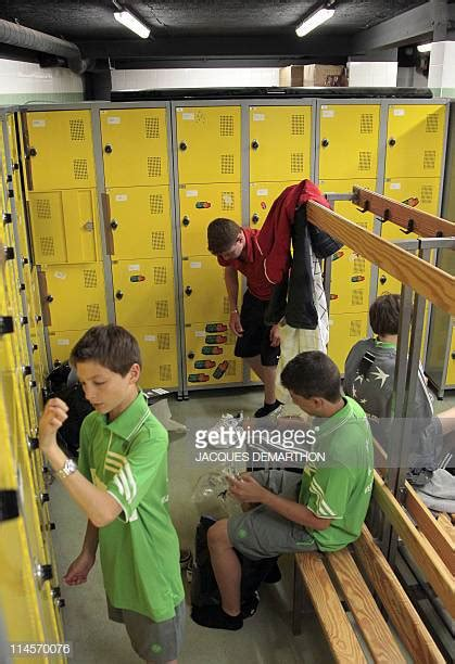 young boys changing  locker room stock