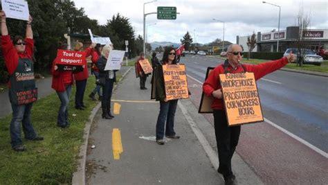 protesting bunnings staff ditch uniform aprons stuffconz