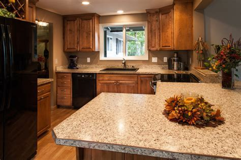 Laminate Countertops, Black Appliances, Birch Cabinets