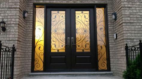 front entry wrought iron woodgrain fiberglass double doors