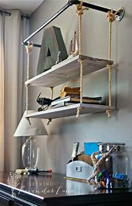 remodelaholic 30 functional wall decor ideas With kitchen cabinets lowes with hanging heavy wall art