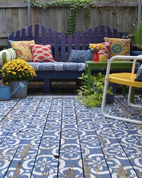 top  stencil  painted rug ideas  wood floors