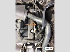 Where is coolant bleeder screw? North American Motoring