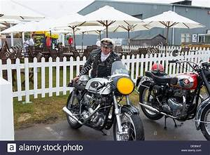 Biker dressed in vintage biker clothing stood next to triton Stock Photo 60450803 - Alamy