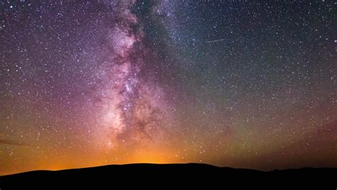 Desert Time Lapse Of Milky Way Galaxy With Clouds Racing