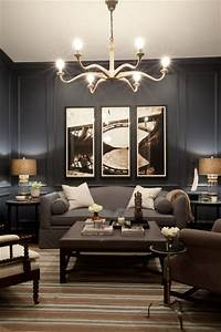 Bachelor pad contemporary family room baltimore by for Kitchen cabinets lowes with wall art for bachelor pad living room