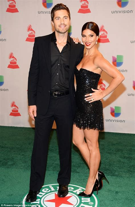 roselyn sanchez stuns  plunging sheer gown  exposes