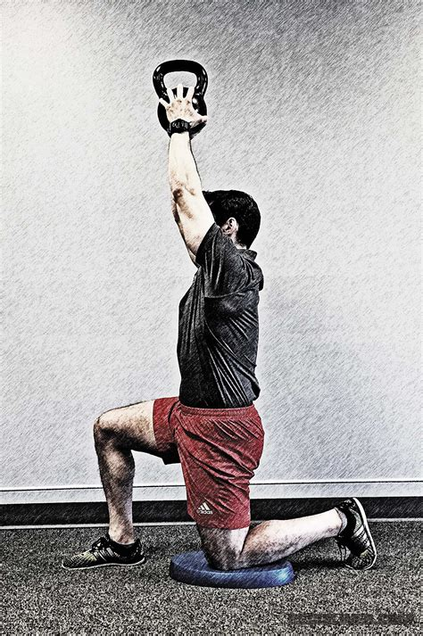 grip strength training overhead kettlebell press hold tight gripping hands firmly crush arch sure both while