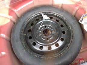 instructions  putting   spare tire